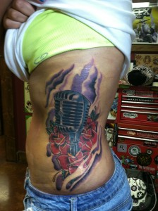 sexy_girly_hot_feminine_microphone_and_roses_color_rib_tattoo_david_meek_tucson_arizona