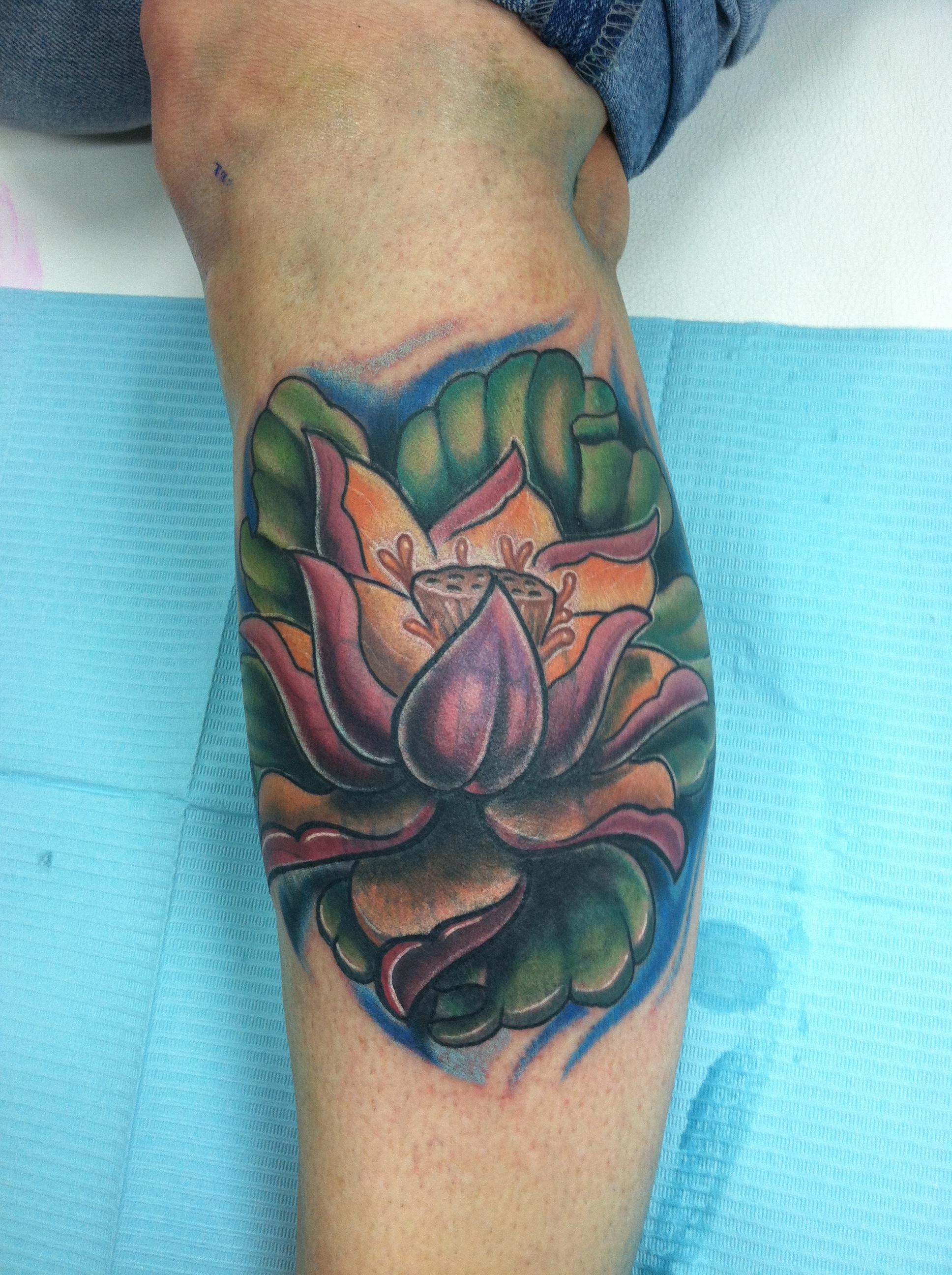sexy_pretty_girly_custom_traditional_realistic_illustrative_lotus_flower_cover_up_color_leg_tattoo_david_meek_true_til_death_tattoo_company_ashtabula_ohio