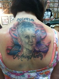 realistic_black_and_grey_memorial_portrait_with_butterfly_and_ribbon_tattoo_david_meek_tattoos_true_til_death_tattoo_company_ashtabula_ohio_tattoo_shops