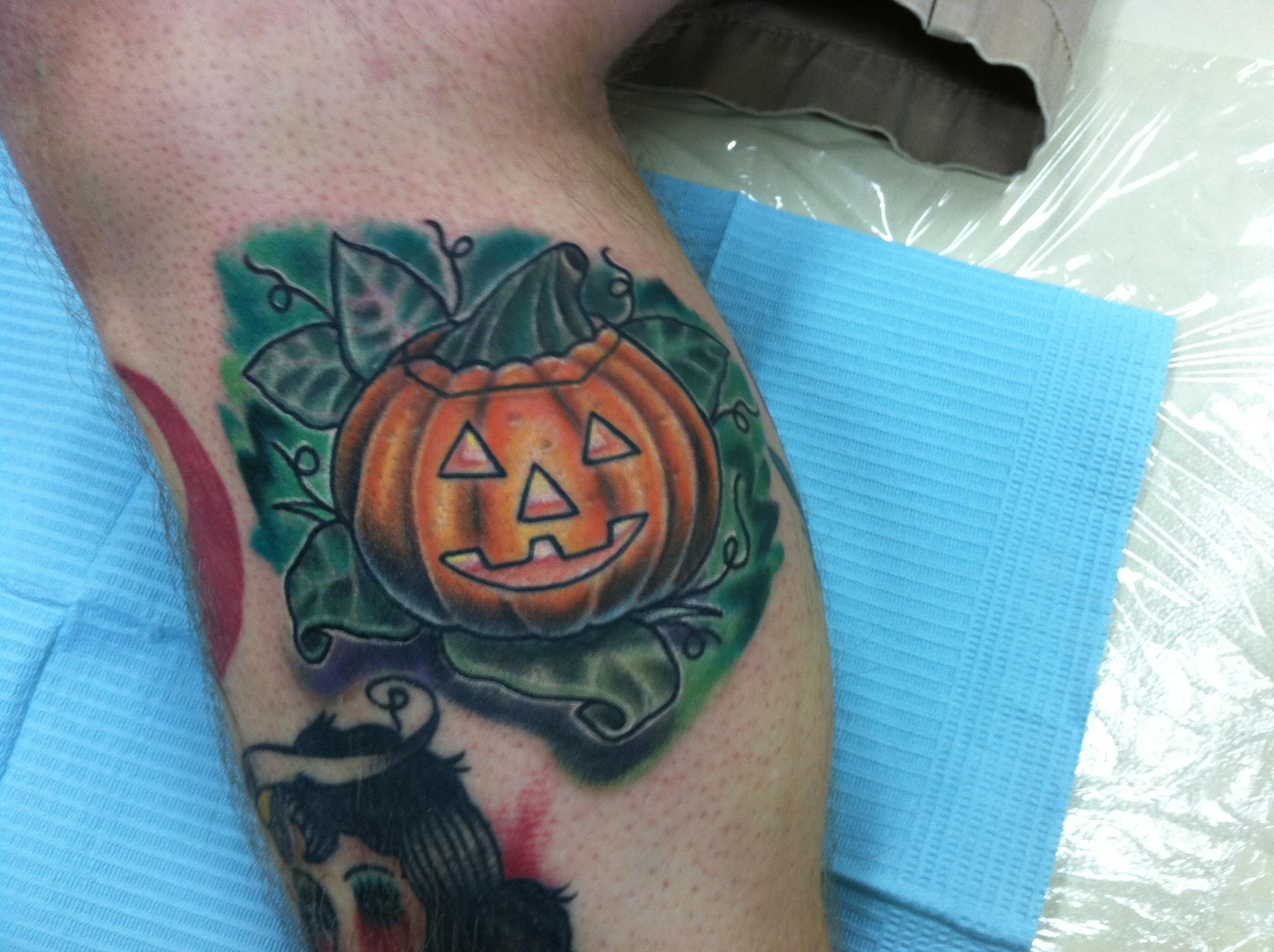scary_creepy_custom_realistic_traditional_halloween_jackolantern_illustrative_tattoo_david_meek_tattoos_true_til_death_tattoo_company_ashtabula_ohio