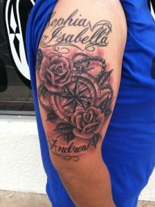 custom black and grey compass and roses arm tattoo by david meek fast lane tattoo tucson arizona